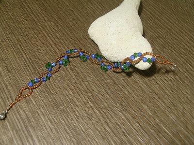 Bracciale di perline con mezzi cristalli