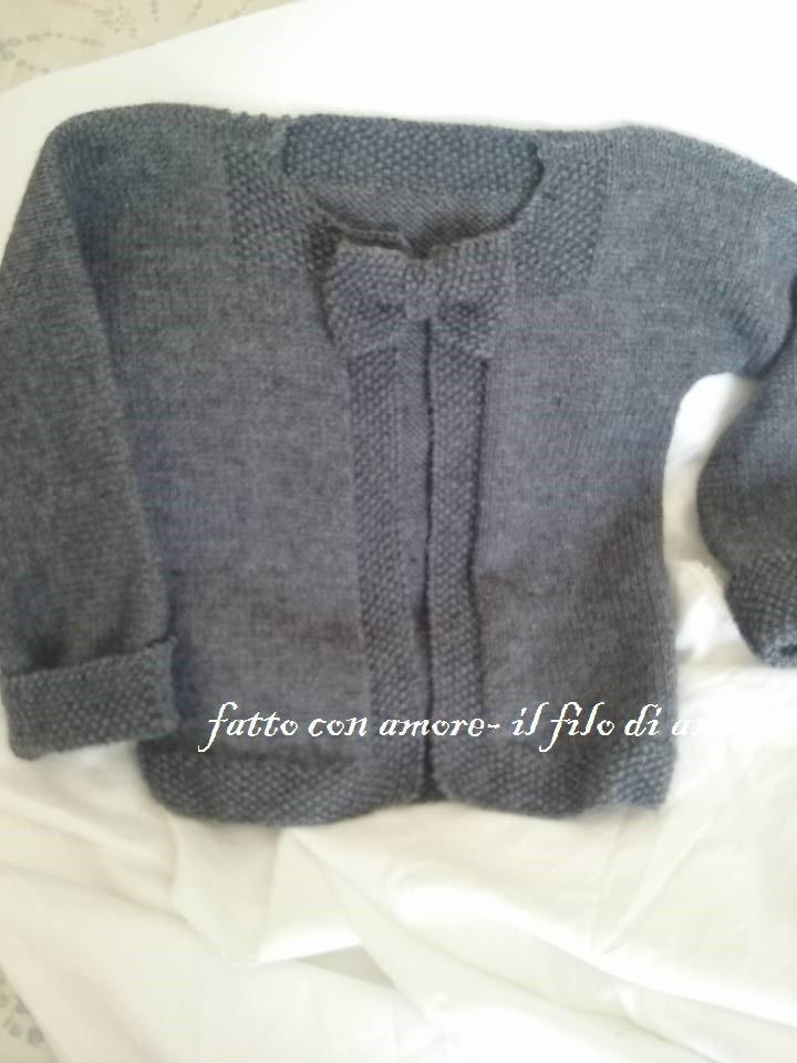 Cardigan /pullover / maglia  in lana  fatto a mano con fiocco