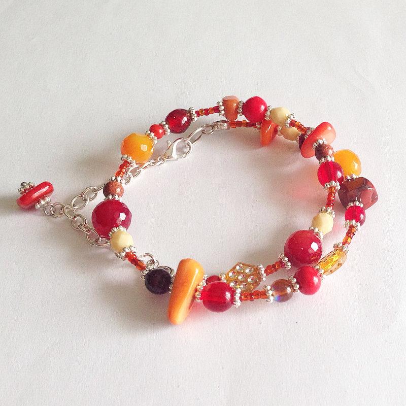 Bracciale armonico rosso arancione da avvolgere
