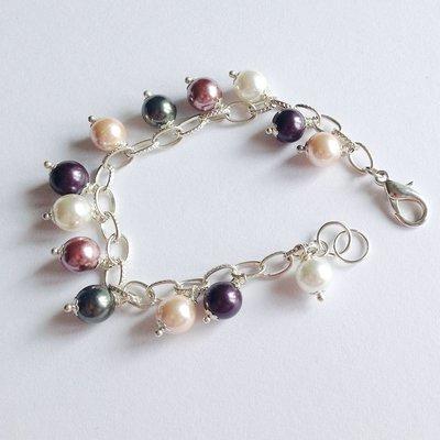 Bracciale elegante con perle cerate e catena