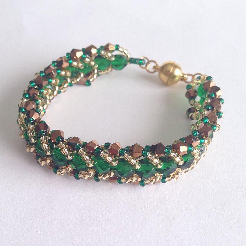 Bracciale verde oro a spirale piatta