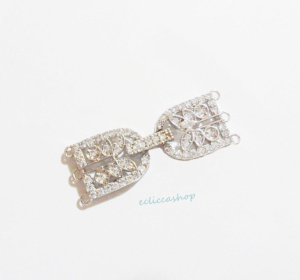 Chiusura pieghevole a forma di fiocco con strass in ottone colore argento  1 pz