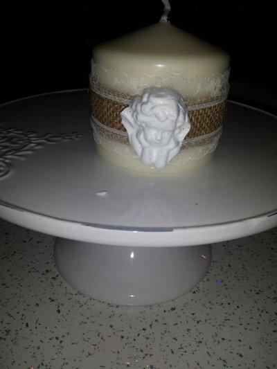 candela con oggetti in gesso