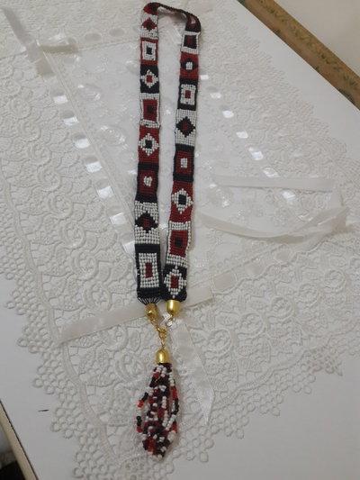 Collana perline telaio
