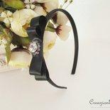Cerchietto per capelli in raso nero con fiocco e cristalli
