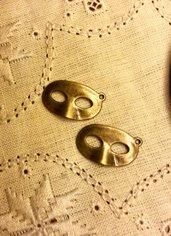 Ciondolo maschera color bronzo antico