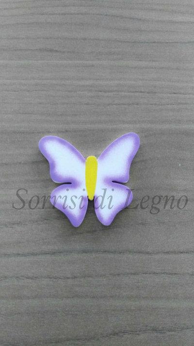 Calamita farfalla dalle ali spiegate in legno