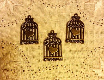 Ciondolo gabbia con cuore color bronzo