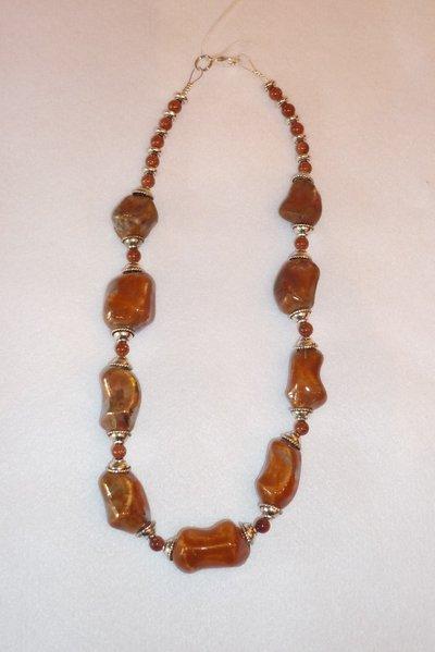 Collana arancio con perle in ceramica