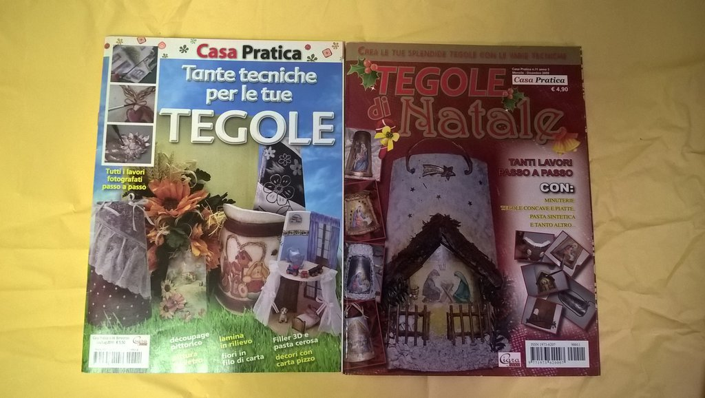 TEGOLE DECORATE IN RILIEVO