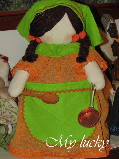 Bambola fermaporta massaia.