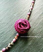 Collana con bottone vintage, in stoffa ,color fucsia ,a forma di fiore con mezzi cristalli di Boemia