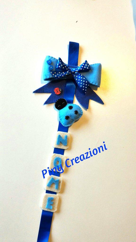 Fiocco nascita azzurro con coccinella portafortuna.