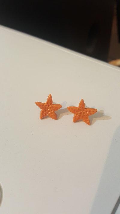 Orecchini a lobo stella marina arancione