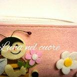 Astuccio in feltro rosa con coccinella