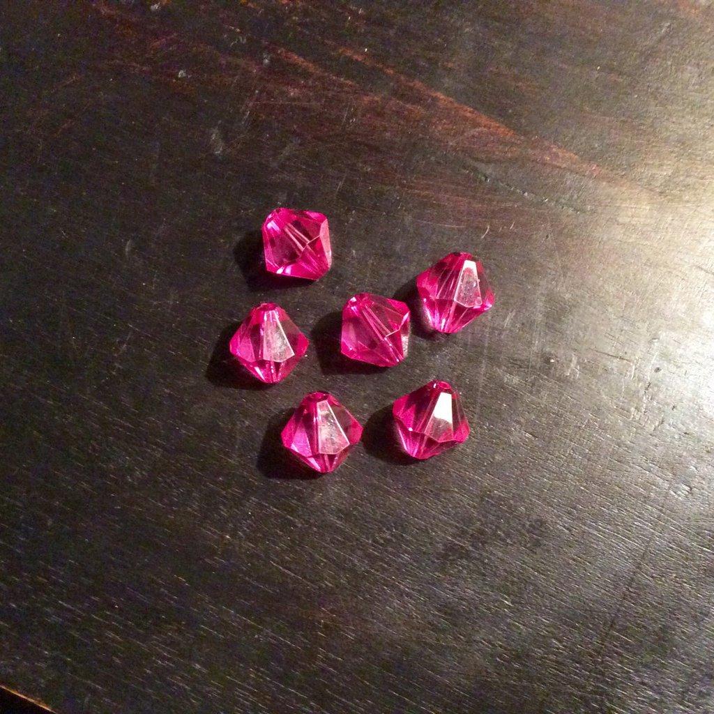 Set di 10 perle in plastica trasparente rosa fucsia