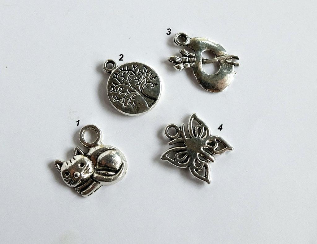 4 Ciondoli in argento tibetano  CIO76-65-64-78