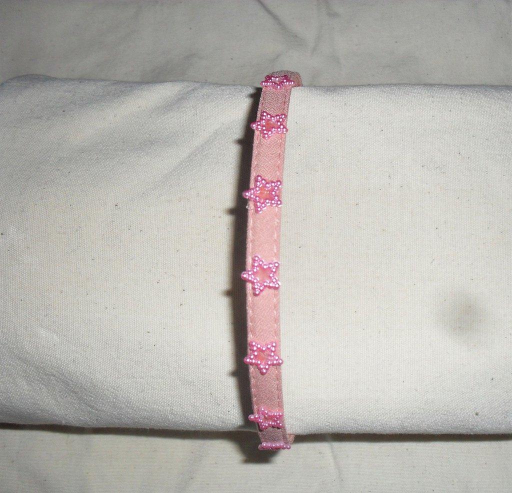Cerchietto rosa con stelline