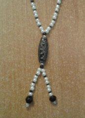 Collana con perle grandi e piccole
