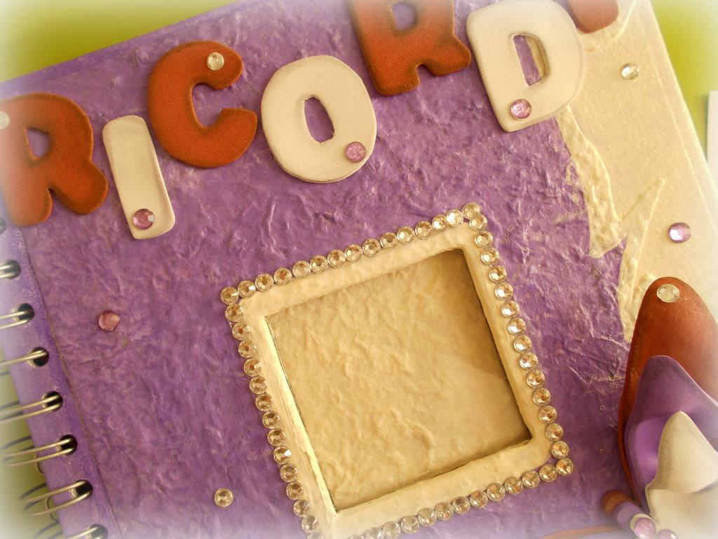 Album portafoto (50 foto 11x15) decorato con carta madagascar  e fommy