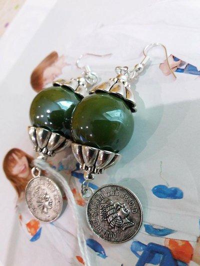 orecchini moneta verde bottiglia