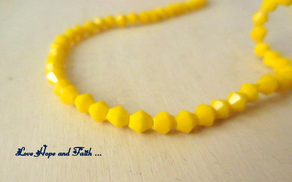 """LOTTO 100 biconi in vetro """"giallo girasole"""" (4mm)"""