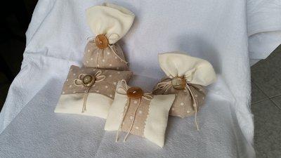 Linea sacchetti confetti in tessuto  con spago