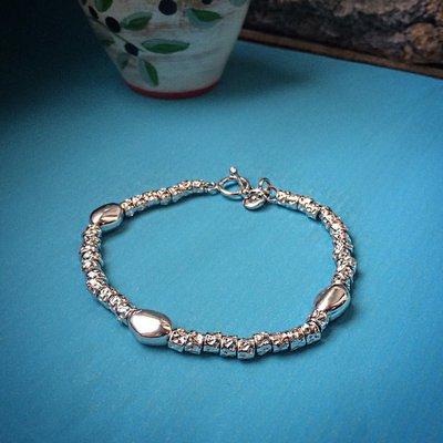 Bracciale pepite martellate e pepite ovali in argento 925