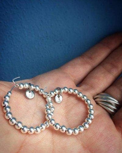 Orecchini cerchio con sfere in argento 925