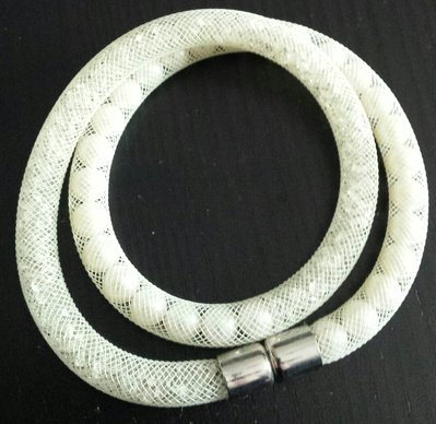 Bracciale stardust rete tubolare bianco panna strass e perle