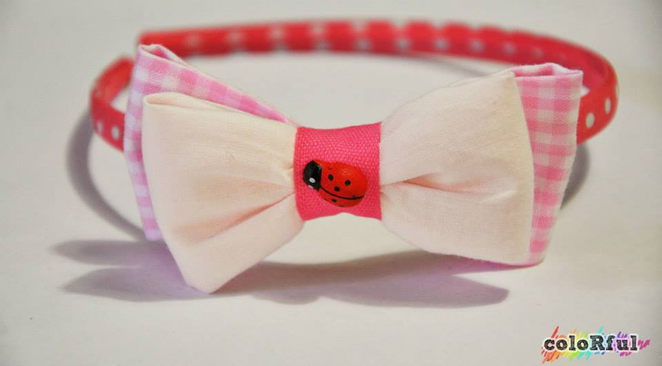 Cerchietto rosa a pois con fiocco