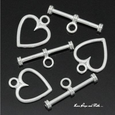 "Chiusura a ""T"" color argento ""Cuore""  (14x11mm-19x16mm) (scod.29859)"
