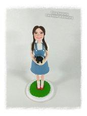 Scultura cake topper Dorothy con Toto' nel cestino