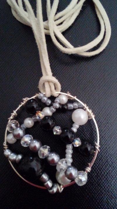 medaglione nero e argento