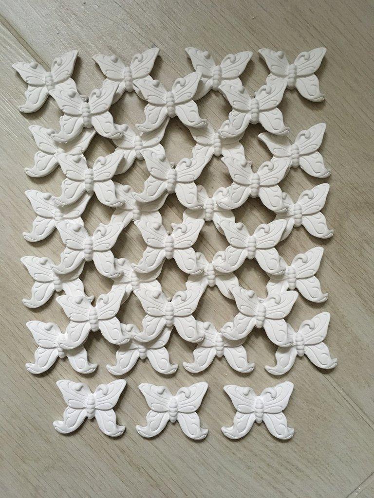 Farfalle calamita economici in polvere di ceramica.