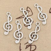 5 charms a forma di nota musicale