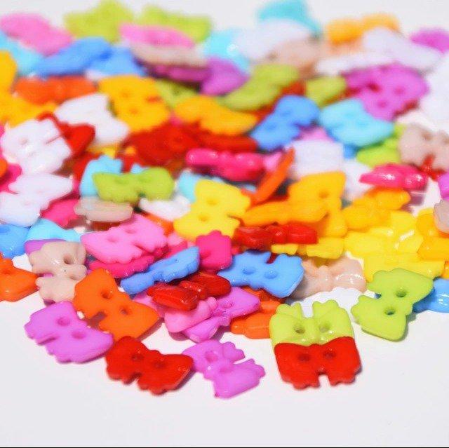 10 bottoni in plastica a forma di fiocco