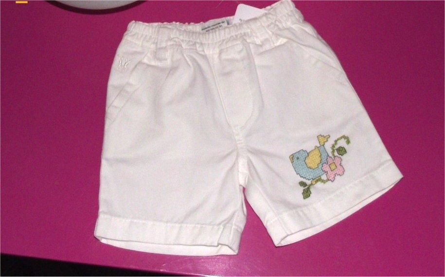 pantaloncini bianchi con passerotto