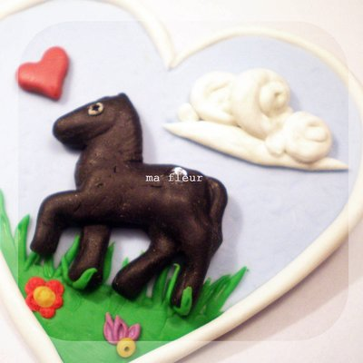 PONY brooch