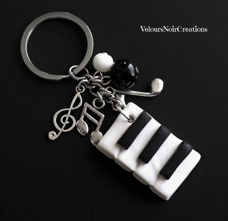 Portachiavi uomo donna pianoforte chiave di violino musica