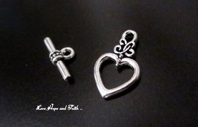 """Chiusura a """"T"""" color argento """"Cuore2""""  (21mmx13mm-17mmx7mm) (scod.20707)"""