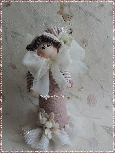 Bambola rosa con la stellina