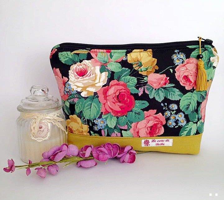 Pochette donna in tessuto floreale