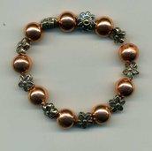 Bracciale in rame per polso medio con fiorellini in metallo brunito
