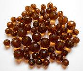 Lotto 60 perle acriliche marrone due misure