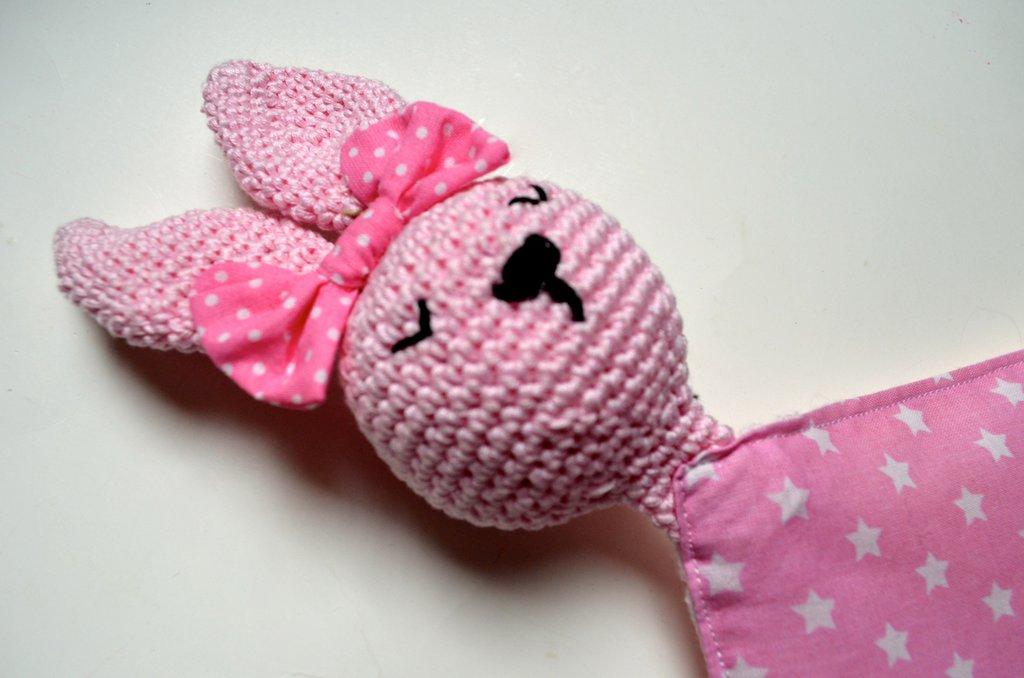 Doudou coniglietta rosa con fiocco e corpo in cotone e mussolina