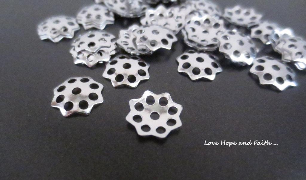 LOTTO 50 copriperla acciaio inox (11mm) (cod. inox new)