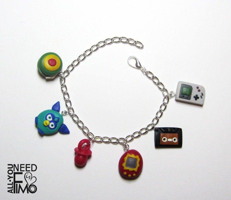 Bracciale anni 90|ciondoli anni 90|ciondolo game boy|ciondolo tamagotchi|ciondolo ciuccio|ciondolo yoyo|ciondolo musicassetta|ciondolo furby