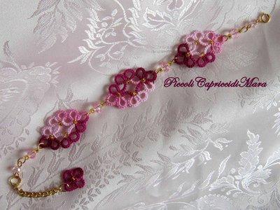 Bracciale rosa ed amaranto al chiacchierino, cristalli rosa, perline dorate
