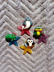 Calamite con animaletti in fimo su stella marina in resina